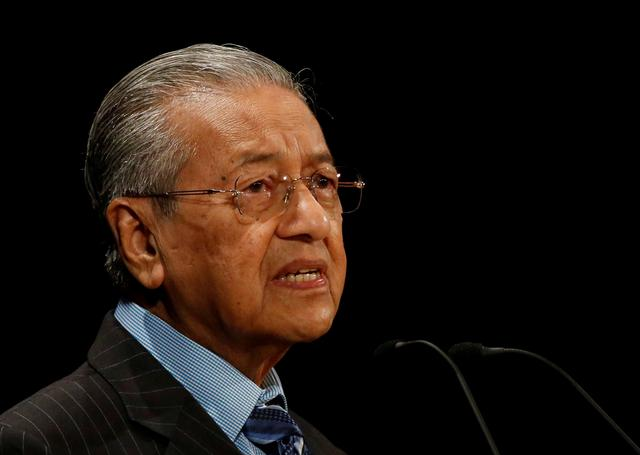 FILE PHOTO : Malaysian Prime Minister Mahathir Mohamad delivers a speech at the International Conference on the Future of Asia in Tokyo, Japan June 11, 2018. REUTERS/Issei Kato