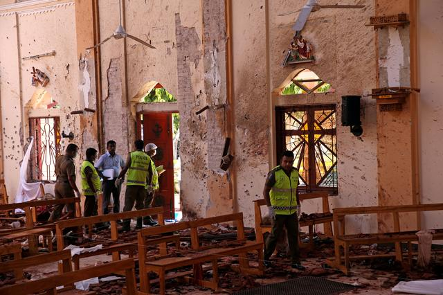 FILE PHOTO: Police officers work at the scene at St. Sebastian Catholic Church, after bomb blasts ripped through churches and luxury hotels on Easter, in Negombo, Sri Lanka April 22, 2019. REUTERS/Athit Perawongmetha/File Photo