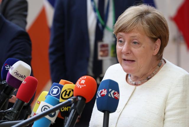 German Chancellor Angela Merkel speaks to the media at the European Union leaders summit in Brussels, Belgium, June 20, 2019. REUTERS/Yves Herman