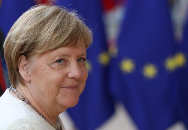 German Chancellor Angela Merkel reacts as she arrives for the European Union leaders summit in Brussels, Belgium, June 20, 2019. REUTERS/Yves Herman