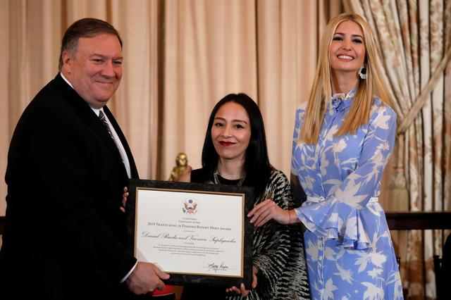 U.S. Secretary of State Mike Pompeo and White House senior advisor Ivanka Trump award Veronica Supliguicha from Ecuador during an event to release of 2019 Trafficking in Persons report at the State Department in Washington, U.S., June 20, 2019. REUTERS/Yuri Gripas
