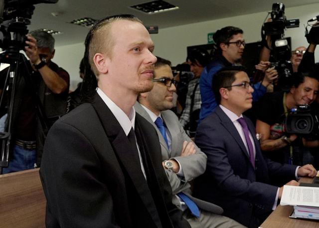 FILE PHOTO: Swedish software developer Ola Bini (L) sits at court in Quito, Ecuador May 2, 2019. REUTERS/Daniel Tapia