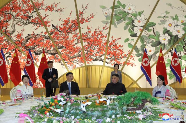 North Korean leader Kim Jong Un and Chinese President Xi Jinping attend a banquet in Pyongyang, North Korea, in this undated photo released on June 21, 2019 by North Korea's Korean Central News Agency (KCNA).  KCNA via REUTERS