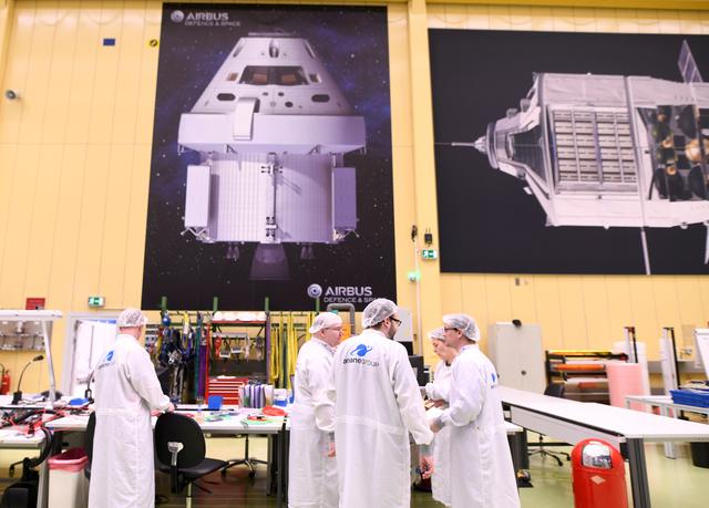 FILE PHOTO: Employees chat at a production line of Airbus' European Service Module (ESM), which is delivered for NASA's Orion Spaceship, at the Airbus plant in Bremen, Germany, February 19, 2019. Picture taken February 19,2019. REUTERS/Fabian Bimmer/File Photo