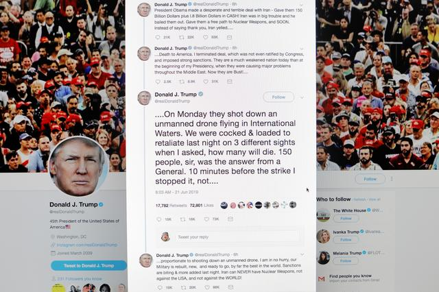 A series of tweets written by U.S. President Donald Trump regarding a retaliatory attack on Iran are displayed on a computer screen in New York, U.S., June 21, 2019. REUTERS/Lucas Jackson