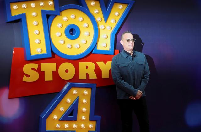 "FILE PHOTO: Cast member Tom Hanks attends the UK premiere of ""Toy Story 4"" in London, Britain, June 16, 2019. REUTERS/Simon Dawson/File Photo"