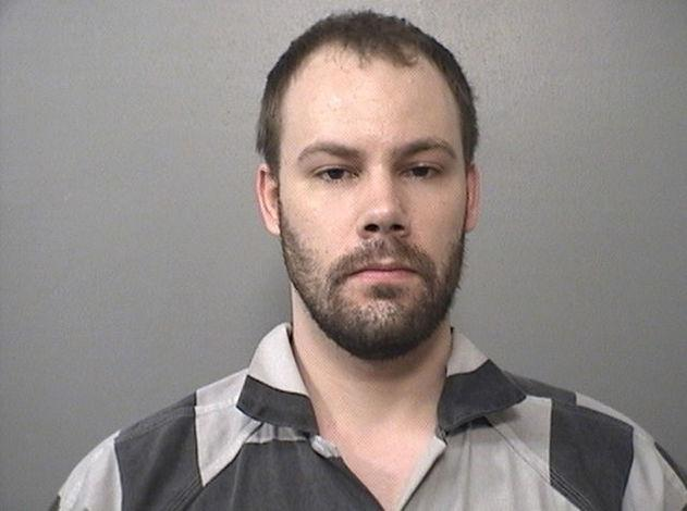 FILE PHOTO: Brendt Christensen, 28, arrested in connection with the disappearance of Yingying Zhang, 26, on June 9, 2017, is shown in this booking photo in Champaign, Illinois, U.S., provided July 5, 2017.  Macon County Sheriff's Office/Handout via REUTERS