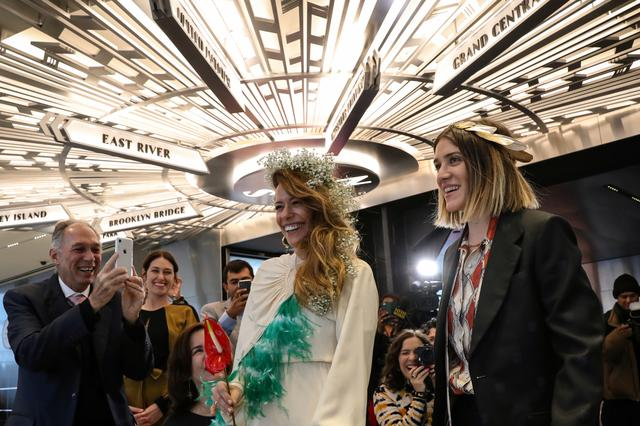 Helena Barquet and Fabiana Faria are greeted by family and friends during their Valentine's Day wedding ceremony at the top of the Empire State Building in New York, U.S., February 14, 2019.  Picture taken February 14, 2019.  REUTERS/Brendan McDermid