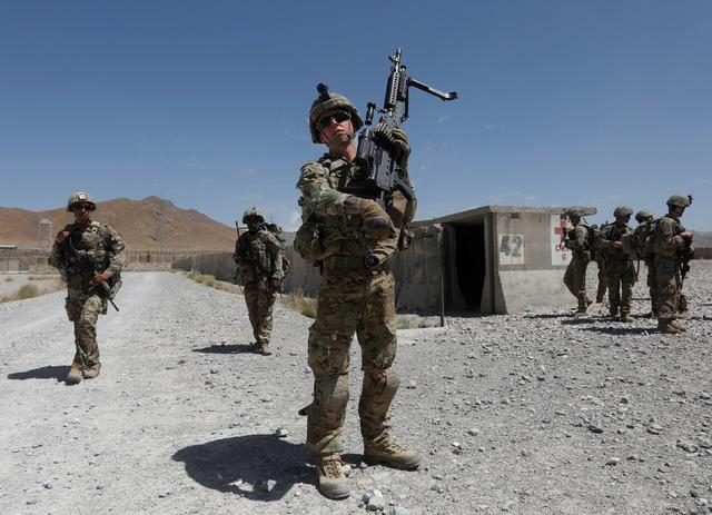 FILE PHOTO: U.S. troops patrol at an Afghan National Army (ANA) base in Logar province, Afghanistan Aug. 7, 2018. REUTERS/Omar Sobhani/File Photo
