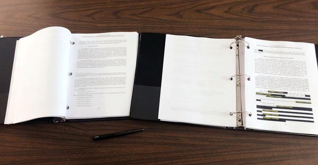 A copy of the Special Counsel Robert Mueller's report that was provided to reporters is seen in Washington, D.C., U.S. April 18, 2019.   REUTERS/Andrew Sullivan