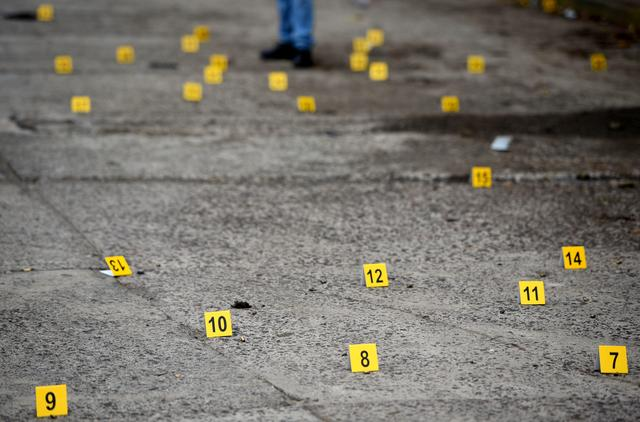 Bullet casings on the ground are pictured at a crime scene after a shootout in the municipality Tuzamapan, in the Mexican state of Veracruz, Mexico, May 16, 2019.  REUTERS/Yahir Ceballos