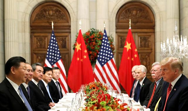 U.S. President Donald Trump, U.S. Secretary of State Mike Pompeo, U.S. President Donald Trump's national security adviser John Bolton and Chinese President Xi Jinping attend a working dinner after the G20 leaders summit in Buenos Aires, Argentina December 1, 2018. REUTERS/Kevin Lamarque