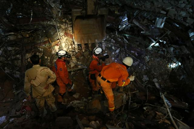 FILE PHOTO: A rescue team attempts to find the missing workers at a collapsed building in Sihanoukville, Cambodia, June 22, 2019. REUTERS/Stringer