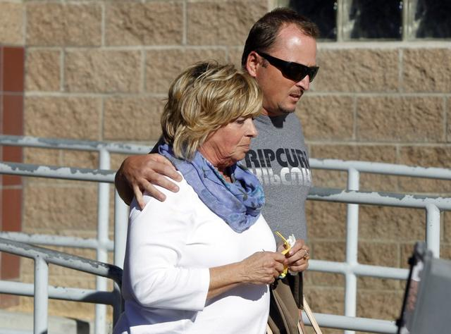 """FILE PHOTO: Susan Blake (L), the mother of Joseph McStay, leaves the courtroom with her son Michael McStay after Charles """"Chase"""" Merritt was in the courtroom for arraignment proceedings for the murder of the McStay family in Victorville, California November 7, 2014. . REUTERS/Alex Gallardo   ("""