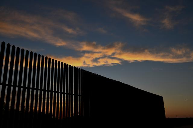 FILE PHOTO - A stretch of border fence in the Rio Grande Valley is pictured near Penitas, Texas, U.S., April 7, 2019.  REUTERS/Loren Elliott