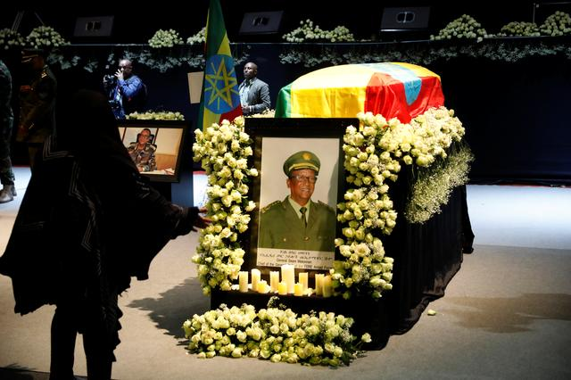 A mourner stands in front of the coffin of Army Chief of Staff Seare Mekonnen, who was shot by his bodyguard, during a memorial ceremony in Addis Ababa, Ethiopia June 25, 2019. REUTERS/Baz Ratner