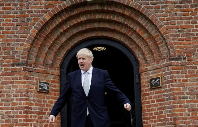 Boris Johnson, a leadership candidate for Britain's Conservative Party, stands outside one of the buildings at Wisley Garden Centre in Surrey, Britain, June 25, 2019. REUTERS/Peter Nicholls