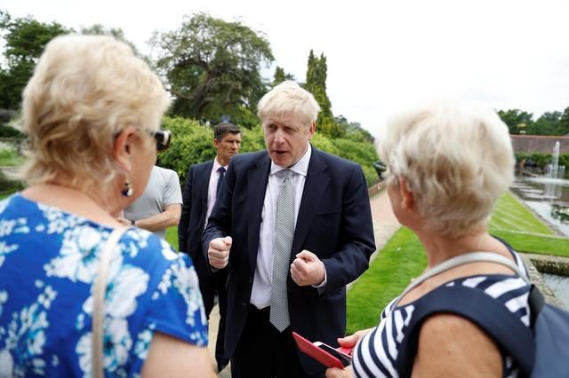 Boris Johnson, a leadership candidate for Britain's Conservative Party, talks with visitors during a walkabout at Wisley Garden Centre in Surrey, Britain, June 25, 2019. REUTERS/Peter Nicholls