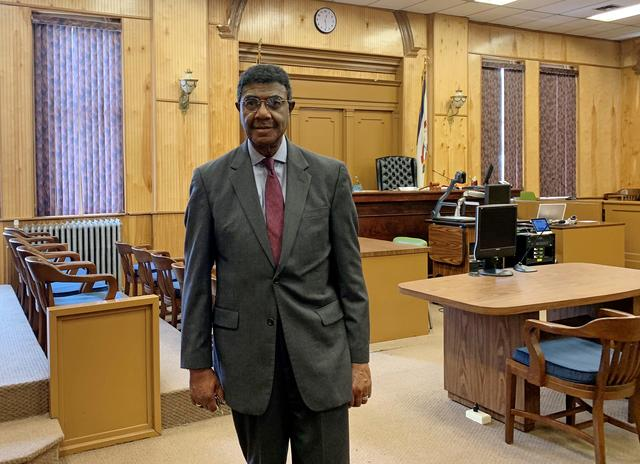 Judge Booker T. Stephens poses in his courtroom in Welch, West Virginia, U.S., February 7, 2019. Picture taken February 7, 2019. REUTERS/Benjamin Lesser