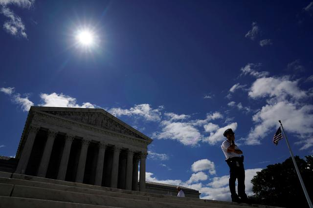 FILE PHOTO: A police officer keeps watch at the U.S. Supreme Court in Washington, U.S., June 21, 2019.  REUTERS/Kevin Lamarque/File Photo
