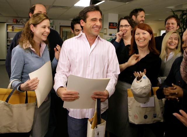 "FILE PHOTO: Actor Steve Carell (C) laughs along with other members of ""The Office"" cast including Jenna Fischer (L), Phyllis Smith, (2rd R, in glasses) and Kate Flannery (2nd R) as he receives certificates for his three Screen Actors Guild Awards nominations for outstanding performance by a male actor in a comedy series in ""The Office,"" outstanding performance by an ensemble in a comedy series in ""The Office,"" and outstanding performance by the cast of a motion picture in ""Little Miss Sunshine,"" on the set of the television show ""The Office,"" in Panorama City, California, January 11, 2007. REUTERS/Danny Moloshok/File Photo"