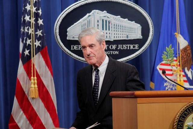 FILE PHOTO: U.S. Special Counsel Robert Mueller departs after delivering a statement on his investigation into Russian interference in the 2016 U.S. presidential election at the Justice Department in Washington, U.S., May 29, 2019. REUTERS/Jim Bourg/File Photo
