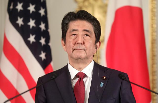 FILE PHOTO: Japanese Prime Minister Shinzo Abe holds a joint news conference with visiting U.S. President Donald Trump (not pictured) in Tokyo, Japan May 27, 2019. REUTERS/Jonathan Ernst/File Photo