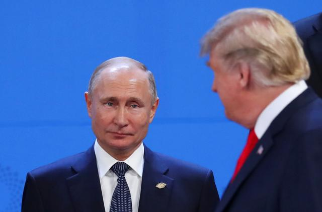 FILE PHOTO: U.S. President Donald Trump and Russia's President Vladimir Putin are seen during the G20 leaders summit in Buenos Aires, Argentina November 30, 2018. REUTERS/Marcos Brindicci