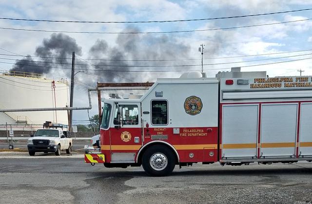 A Philadelphia Fire Department truck attends a massive fire at Philadelphia Energy Solutions Inc's oil refinery in Philadelphia, Pennsylvania, U.S. in this June 21, 2019 handout photo.     Philadelphia Fire Department/Handout via REUTERS