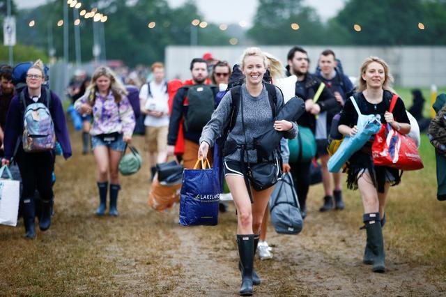People carry their possesions as they arrive for Glastonbury Festival at Worthy farm in Somerset, Britain June 26, 2019. REUTERS/Henry Nicholls
