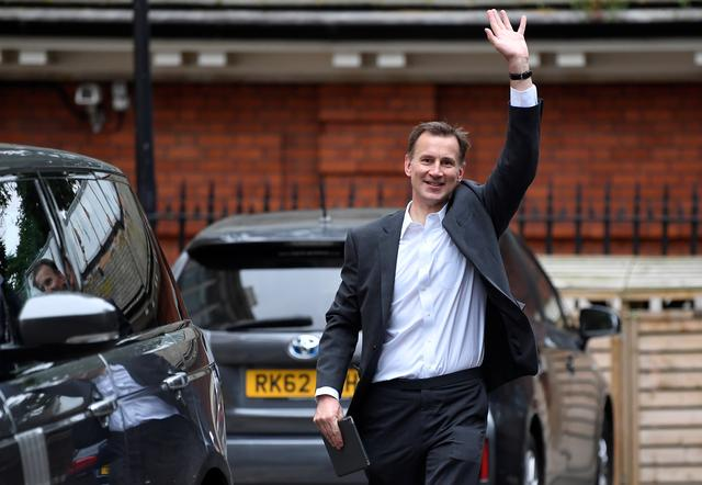 Conservative Party leadership candidate Jeremy Hunt waves as he leaves his home in London, Britain, June 26, 2019. REUTERS/Toby Melville
