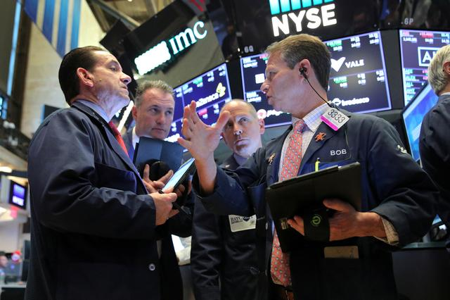 FILE PHOTO: Traders work on the main trading floor after the opening bell at New York Stock Exchange (NYSE) in New York, U.S. June 20, 2019.  REUTERS/Brendan McDermid/File Photo