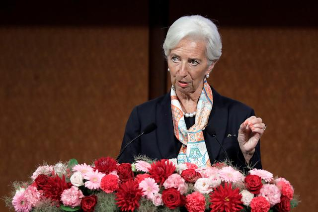 """FILE PHOTO: Christine Lagarde, managing director of the International Monetary Fund (IMF), speaks at the Group of 20 (G-20) high-level seminar on financial innovation """"Our Future in the Digital Age"""", on the sidelines of the G-20 finance ministers and central bank governors meeting in Fukuoka, Japan, on Saturday, June 8, 2019.  Kiyoshi Ota/Pool via REUTERS/File Photo"""