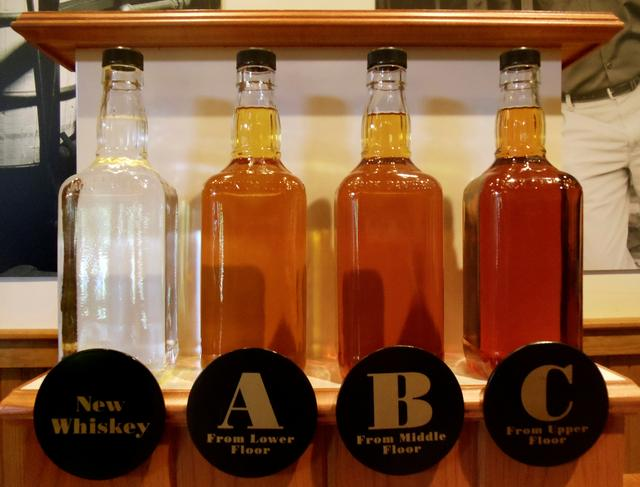 FILE PHOTO: Bottles showing the barrel aging process are seen at the Jack Daniel's distillery in Lynchburg, Tennessee May 10, 2011.  REUTERS/ Martinne Geller/File Photo