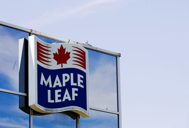 FILE PHOTO: A sign for the Maple Leaf food processing plant is seen in Toronto August 21, 2008. REUTERS/Mark Blinch (CANADA)/File Photo