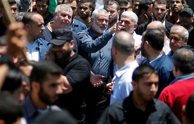 Hamas Chief Ismail Haniyeh, Gaza's Hamas Chief Yehya Al-Sinwar, and other Palestinian factions' leaders take part in a protest against Bahrain's workshop for U.S. Middle East peace plan, in Gaza City, June 26, 2019. REUTERS/Mohammed Salem