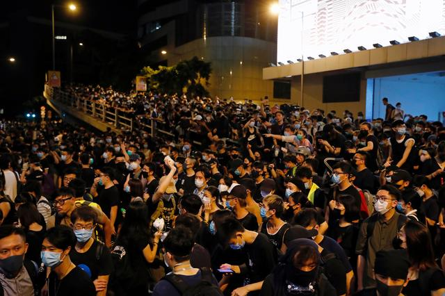 Demonstrators protest outside police headquarters, demanding Hong Kong's leaders to step down and withdraw the extradition bill, in Hong Kong, China June 26, 2019. REUTERS/Tyrone Siu