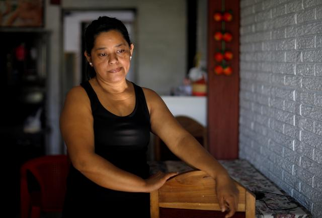 Rosa Ramirez, mother of Oscar Alberto Martinez Ramirez, a migrant who drowned in the Rio Grande River with his daughter Valeria during their journey to the U.S., is pictured at her house in the Altavista neighbourhood in San Martin, El Salvador June 26, 2019. REUTERS/Jose Cabezas
