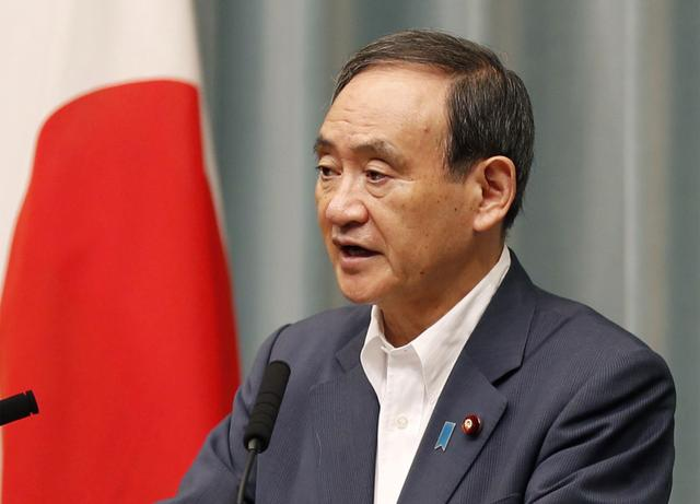 FILE PHOTO: Japanese Chief Cabinet Secretary Yoshihide Suga speaks at a news conference about North Korea's missile launch in Tokyo, Japan in this photo taken by Kyodo on August  29, 2017. Mandatory credit Kyodo/via REUTERS