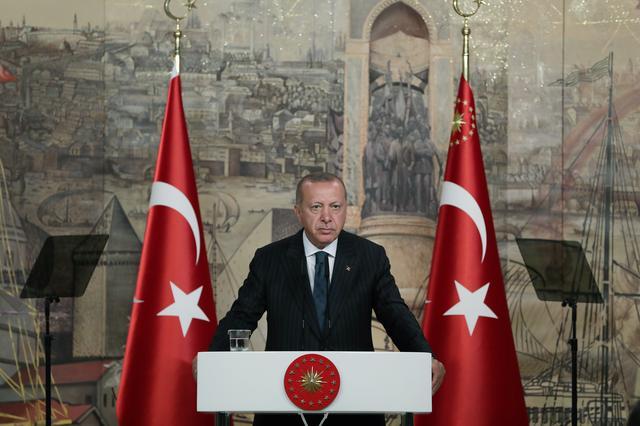 FILE PHOTO - Turkish President Tayyip Erdogan speaks during a meeting with members of the international media in Istanbul, Turkey, June 20, 2019. Kayhan Ozer/Presidential Press Office/Handout via REUTERS