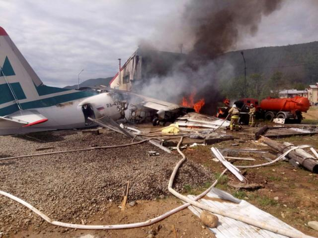 An Antonov An-24 passenger plane is seen on fire after an emergency landing in the town of Nizhneangarsk, Russia June 27, 2019.  Russian Emergencies Ministry/Handout via REUTERS