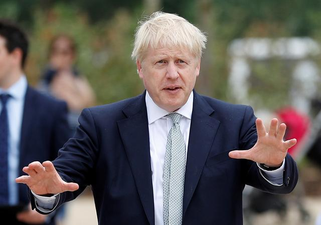 FILE PHOTO: Boris Johnson, a leadership candidate for Britain's Conservative Party, arrives for a walkabout at Wisley Garden Centre in Surrey, Britain, June 25, 2019. REUTERS/Peter Nicholls