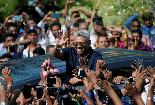 FILE PHOTO: Sri Lanka's former defense secretary Gotabaya Rajapaksa greets supporters after his return from the United States, in Katunayake, Sri Lanka April 12, 2019. REUTERS/Dinuka Liyanawatte/File Photo