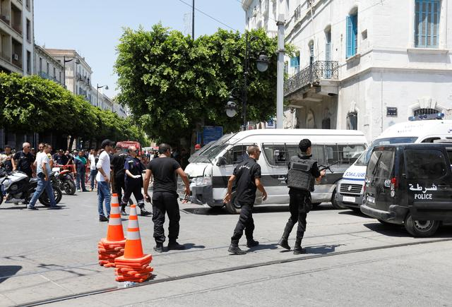 Police officers are seen at the site of an explosion in downtown Tunis, Tunisia, June 27, 2019. REUTERS/Zoubeir Souissi