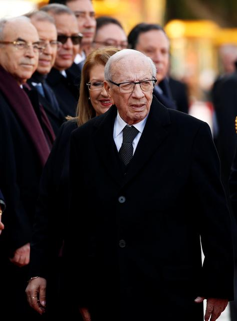 Tunisian President Beji Caid Essebsi and Maltese President Marie-Louise Coleiro Preca (partly hidden) attend a welcomeing ceremony at the start of his two-day state visit to Malta, in Valletta, Malta February 5, 2019.  REUTERS/Darrin Zammit Lupi
