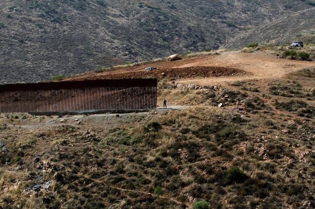 A general view shows a U.S. Border Patrol agent guarding a section of the border fence between Mexico and the United States as pictured from Tijuana, Mexico June 20, 2019. REUTERS/Jorge Duenes