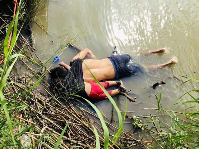 The bodies of Salvadoran migrant Oscar Alberto Martinez Ramirez and his daughter Valeria are seen after they drowned in the Rio Bravo river while trying to reach the United States, in Matamoros, in Tamaulipas state, Mexico June 24, 2019. REUTERS/Stringer