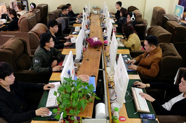 FILE PHOTO: Employees work on labeling different items for data collection on computer screens, which would serve for developing artificial intelligence (AI) and machine learning technology, at the Qian Ji Data Co in Jia county, Henan province, China March 20, 2019. REUTERS/Irene Wang