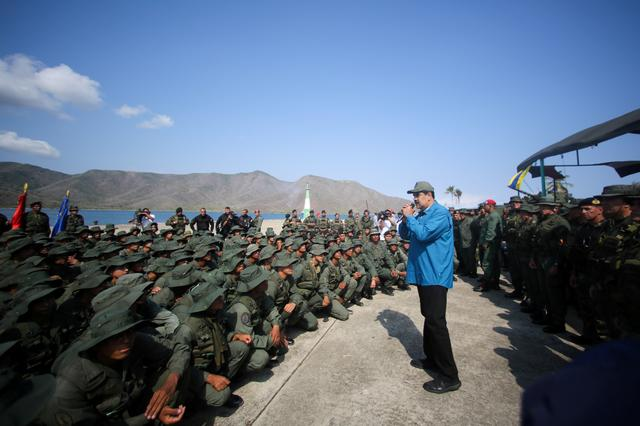 FILE PHOTO: Venezuela's President Nicolas Maduro speaks to soldiers while he attends a military exercise in Turiamo, Venezuela February 3, 2019. Miraflores Palace/Handout via REUTERS/File Photo