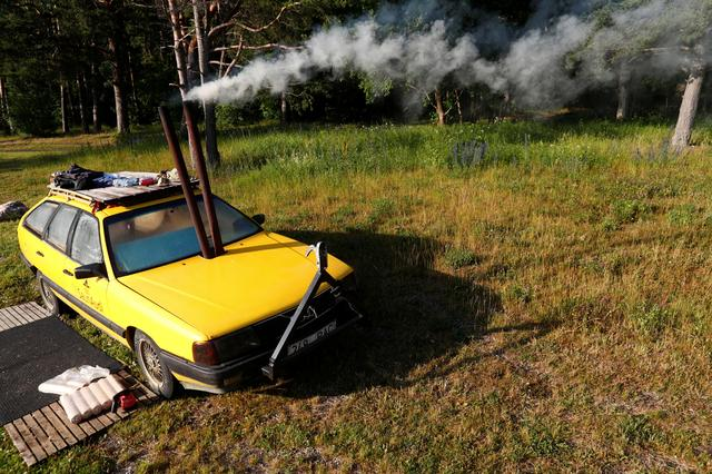 A smoke runs out of an old yellow Audi car converted into a small sauna in Tallinn, Estonia June 27, 2019. Picture taken June 27, 2019. REUTERS/Ints Kalnins